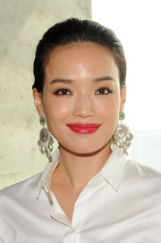 Shu Qi looked radiant with a swipe of glossy red lipstick at the Mercedes-Benz Fashion Week event.