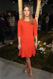 Adele Exarchopoulos brought a bright burst of color to the Boss Women fashion show with this red-orange cocktail dress.