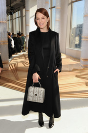 Julianne Moore broke up her black theme with a gray snakeskin purse.