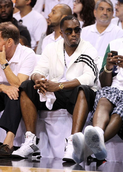 Sean Combs blended in with the crowd in his Nike sneakers and sporty outfit while watching a basketball game.