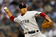 Daisuke Matsuzaka proudly wears his Boston Red Sox cap in a game against the Yankees.