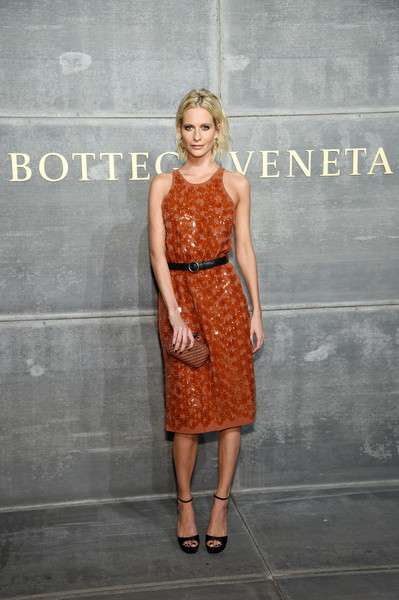 Poppy Delevingne capped off her look with a textured brown clutch, also by Bottega Veneta.