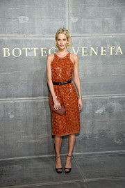 Poppy Delevingne paired her chic dress with black platform sandals.