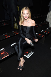 Lauren Santo Domingo teamed black peep-toe mules with an off-the-shoulder look for the Bottega Veneta fashion show.