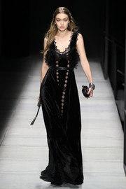 Gigi Hadid was the picture of elegance in a black velvet gown with lace inserts while walking the Bottega Veneta runway.