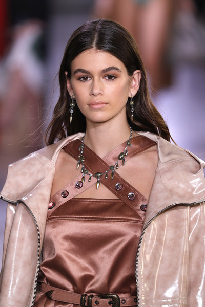 Kaia Gerber walked the Bottega Veneta Spring 2018 show wearing a silver charm necklace and matching earrings.