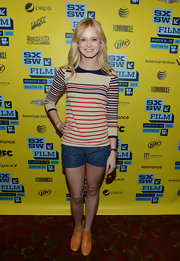 Sara Paxton paired cool print denim shorts with a striped sweater for a casual but preppy look at SXSW.