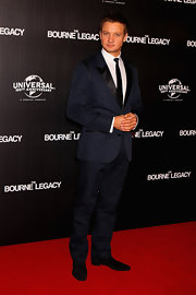 Jeremy Renner topped off his two-tone suit with swanky suede Christian Louboutin loafers.