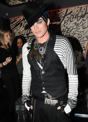 American Idol finalist Adam Lambert donned a slick black fedora at this Boy George single release event.