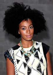 Solange paired her Aztec-print outfit with a turquoise resin necklace.