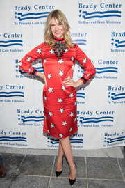 January Jones looked vibrant and chic in a star-print midi dress by Christopher Bu at the Brady Center Bear Awards Gala.