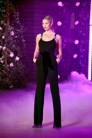 Karlie Kloss worked an elegant black jumpsuit with a velvet belt and bejeweled shoulder straps on the Brandon Maxwell runway.