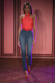 Joan Smalls was sweet and sexy at once in a fitted pink halter top while walking the Brandon Maxwell runway.