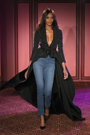 Jourdan Dunn's skinny jeans made a casual contrast to her elegant coat.