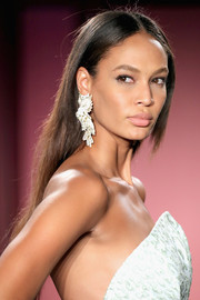 Joan Smalls wore a simple straight hairstyle with a center part while walking the Brandon Maxwell runway.