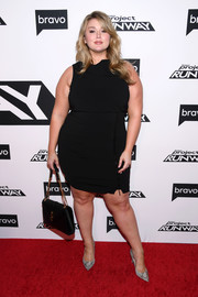 Hunter McGrady styled her dress with a pair of gray python pumps.