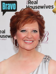 Caroline Manzo topped off her elegant outfit with a pair of diamond hoop earrings at the premiere of 'The Real Housewives of New Jersey' Season Two.