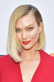 Karlie Kloss matched her lipstick to her red outfit.