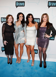 Even without embellishments, Caroline Manzo's sheer-sleeved LBD at the 2012 Bravo Upfront looked downright elegant.