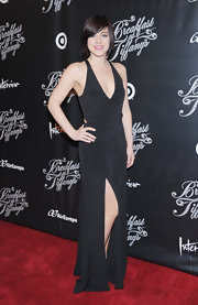 Krysta Rodriguez showed some serious skin with this black gown with a plunging neckline and a front slit.