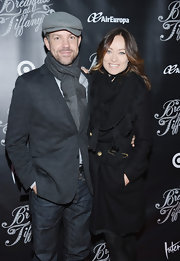 Olivia Wilde chose this black tube scarf to top off her evening look at the opening night of 'Breakfast at Tiffany's.'