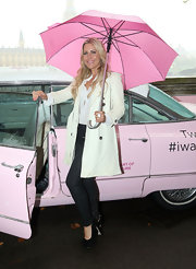 Heidi Range posed for the Breast Cancer Campaign wearing a white trench coat.