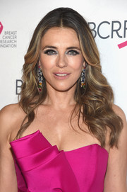 Elizabeth Hurley attended the 2018 Hot Pink Gala wearing her signature feathery waves.