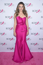 Elizabeth Hurley looked ultra glam in a strapless fuchsia gown by Badgley Mischka at the 2018 Hot Pink Gala.