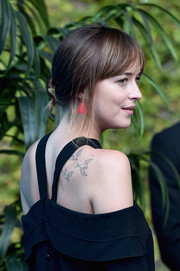 Dakota Johnson kept it relaxed with this loose, twisted bun while attending a UN event.