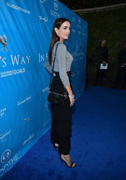 Camilla Belle arrived for the UN special event carrying a sparkly black Marc Jacobs Snapshot bag.