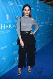 Camilla Belle looked tres trendy in a gray cold-shoulder turtleneck by Osman while attending a UN event.
