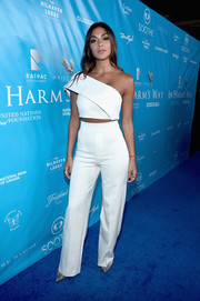Nicole Scherzinger finished off her all-white look with a pair of high-waisted pants.