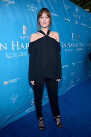 Dakota Johnson completed her outfit with a pair of black ankle-strap sandals by Jimmy Choo.