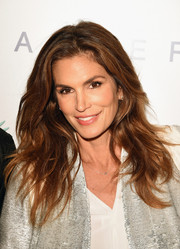 Cindy Crawford attended Brian Bowen Smith's Wildlife show wearing her hair in edgy, piecey waves.