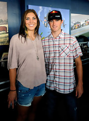 Hope Solo opted for a relaxed look in a slouchy taupe top and cut-off shorts.