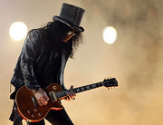 A studded top hat added major sparkle to Slash's look during the Super Bowl halftime show.