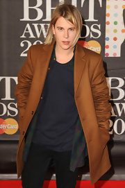 Tom Odewll donned a brown wool coat over an open plaid shirt at the 2013 Brit Awards.