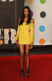 Jourdan Dunn wore the miniest of mini dresses, showing off her teeny figure and long legs in this yellow embroidered off-the-shoulder dress. Long straight locks kept to the sleek and sexy theme.