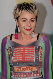 Jaime Winstone donned over sized geometric dangle earrings for added pizazz at the 2013 Brit Awards.