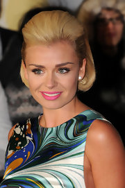 Katherine Jenkins kept her make up to a minimal but added a touch of color with a bright pink lip color.