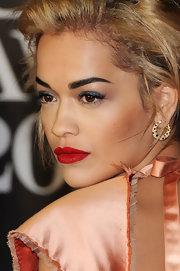 Rita Ora opted for less flashy gold hoops for her 2013 Brit Awards look.