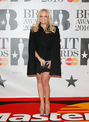 Emma Bunton paired her coat with sky-high nude platform pumps.