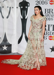 Charli XCX chose a pair of PVC mules to complete her red carpet attire.