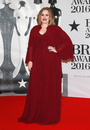 Adele opted for a boho wine-colored gown by Giambattista Valli for her Brit Awards red carpet look.