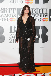 Pixie Geldof made a sexy appearance at the Brit Awards in a sheer black wrap dress.