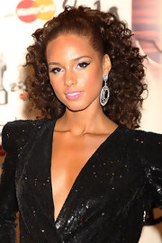 "Alicia looked radiant at the Brit Awards where she was set to preform her hit song with Jay-Z ""Empire State Of Mind"". She was draped in a sequin dress and diamond hoop earrings and completed her look with a bouncy curls, which were pulled back in a high ponytail."