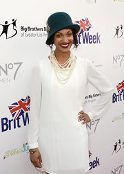 Cynthia Addai-Robinson added instant elegance to her ensemble with layers of pearl necklaces at the BritWeek Celebrates Downton Abbey event.
