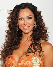 Sofia Milos was spotted at BritWeek wearing her long voluminous tresses in bouncy spiral curls.