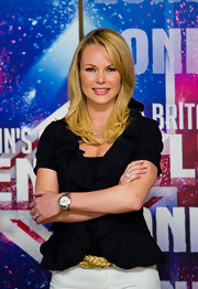 A braided gold belt peeked out from under Amanda Holden's black jacket at the 'Britain's Got Talent' press lunch.