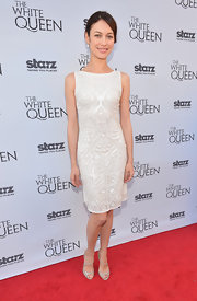Olga Kurylenko gave life to the simple white dress when she donned this sequined, patterned sheath.